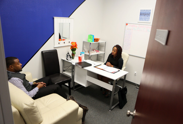 Devin Brooks, left, CEO of the Brooks Behavioral Health Center, speaks with Keena Tate, direct supervisor, at the Brooks Behavioral Health Center facility Thursday, Jan. 30, 2014, in North Las Veg ...