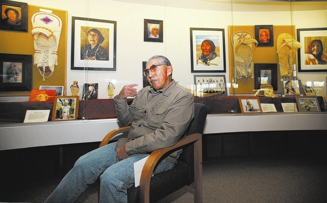 Paiute Tribal Elder Ralph Burns talks at the Pyramid Lake Museum and Visitors Center, in Nixon, Nev., on Wednesday, Jan. 22, 2014. A painting of his grandmother, the large image above his right ha ...