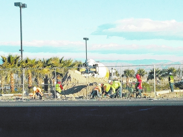 Workers, shown here Tuesday morning, have returned to the Cowabunga Bay Water Park project scheduled to open in late May on 23 acres in Henderson. The project was delayed last May. (Arnold M. Knig ...