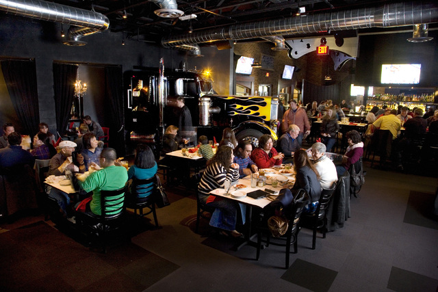 Customers relax with meal, drink and conversation in the vibrant atmosphere of Pizza Rock restaurant in downtown Las Vegas. (Jeferson Applegate/Las Vegas Review-Journal)