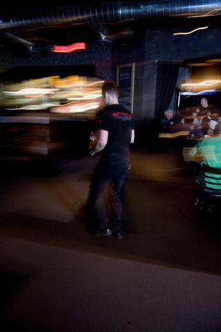 A server works at the Pizza Rock restaurant in downtown Las Vegas. (Jeferson Applegate/Las Vegas Review-Journal)