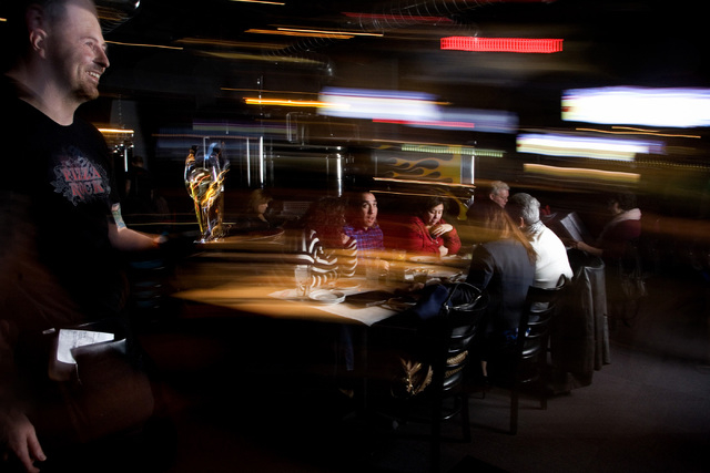 Louis Waterbury, serves food and beverages at the Pizza Rock restaurant in downtown Las Vegas. (Jeferson Applegate/Las Vegas Review-Journal)