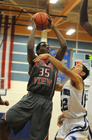 Arbor View's Terrell Butler (35) takes a shot at the basket over Sierra Vista's defender Apollo Corley (22) earlier this season. Butler is one of three players averaging 16 or more points for the  ...