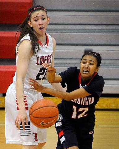Coronado's Grace Green (12) passes the ball around Liberty's Kealy Brown on Tuesday. (David Becker/Las Vegas Review-Journal)