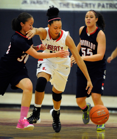 Liberty's Aubre Fortner, center, brings the ball down court against Coronado's Dajah Washington, left, and Kayla Watterson on Tuesday night. (David Becker/Las Vegas Review-Journal)