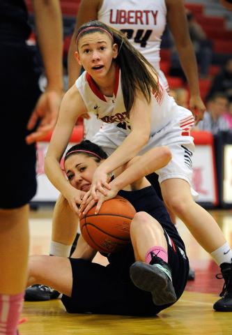 Liberty's Kealy Brown, top, and Coronado's Skylar Feldman battle for a loose ball during a girls high school basketball game at Liberty High School on Tuesday, Feb. 4, 2014. (David Becker/Las Vega ...