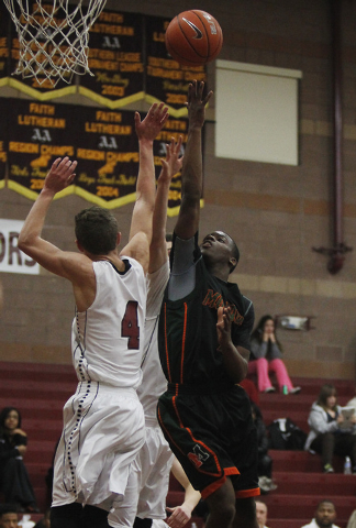 Mojave's Melvin Irvey (1) shoots over Faith Lutheran's Blake Bell (4) on Thursday. Irvey scored 17 points to help the Rattlers to a 57-46 road victory. (Jason Bean/Las Vegas Review-Journal)