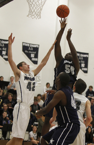 Agassi Prep's Wa'T Manor (50) shoots over The Meadows' Brandon Rufty (42) on Tuesday. Manor had 10 points and seven reboudns to help the Stars rally for a 58-52 win. (Jason Bean/Las Vegas Review-J ...