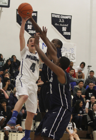 The Meadows' Matthew Biafore (4) drives past Agassi Prep's Darius Coaxum (42) and Dennis Walker (44) on Tuesday. Baifore led the Mustangs with 11 points, but the Stars won the game, 58-52. (Jason  ...