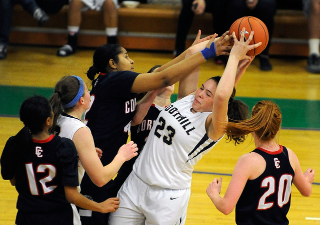 Foothill's Indoneisha Struve(23) grabs a rebound against Coronado's Samantha Green during a Sunrise Region semifinal game at Green Valley on Thursday. Foothill won 66-50. (David Becker/Las Vegas R ...