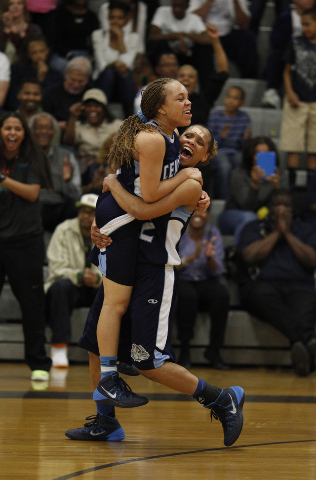 Centennial's Teirra Hicks lifts Tramina Jordan in celebration after the Bulldogs defeated Bishop Gorman in the Sunset Region championship game at Durango on Friday. (John Locher/Las Vegas Review-J ...