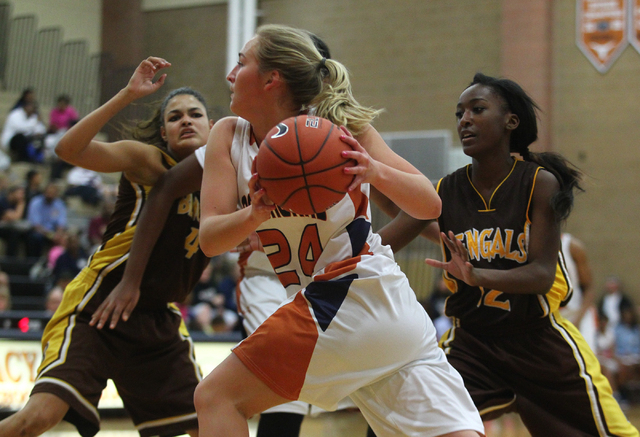 Legacy's Carolina Rahkonen (24) drives to the basket past Bonanza's Acacia Williams, right, in the Longhorns' 52-31 home victory on Thursday. (Chase Stevens/Las Vegas Review-Journal)