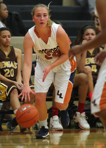 Legacy's Carolina Rahkonen, a foreign exchange student from Finland, brings the ball up court against the Bengals. Averaging 16.1 points per game, Rahkonen leads Legacy into the Sunset Regional qu ...