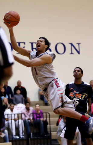 Findlay Prep's Rashad Vaughn, right, the No. 7 prospect in the nation according to Rivals.com, committed to UNLV during a TV announcement Tuesday in Las Vegas. He's shown here during action agains ...