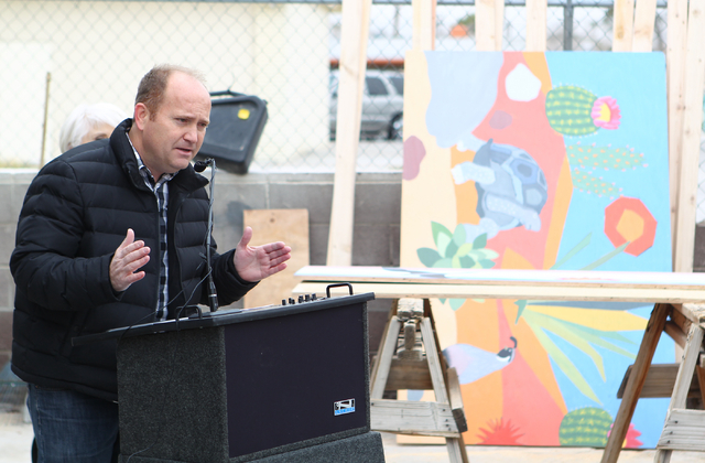 Artist Markus Tracy speaks at the unveiling of a new program where vacant and abandoned homes will be fitted with painted plywood panels, at a home at 106 Shiloah Drive in Las Vegas on Thursday, F ...