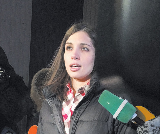 Nadezhda Tolokonnikova speaks to the media after leaving a prison in Krasnoyarsk, Russia, on Dec. 23.  Tolokonnikova, Maria Alekhina and three others were detained at a police station Tuesday whil ...