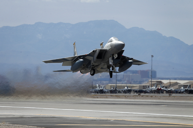 An F-15 takes off from Nellis Air Force base in Las Vegas during Red Flag exercises Tuesday, Feb. 4, 2014. (John Locher/Las Vegas Review-Journal)