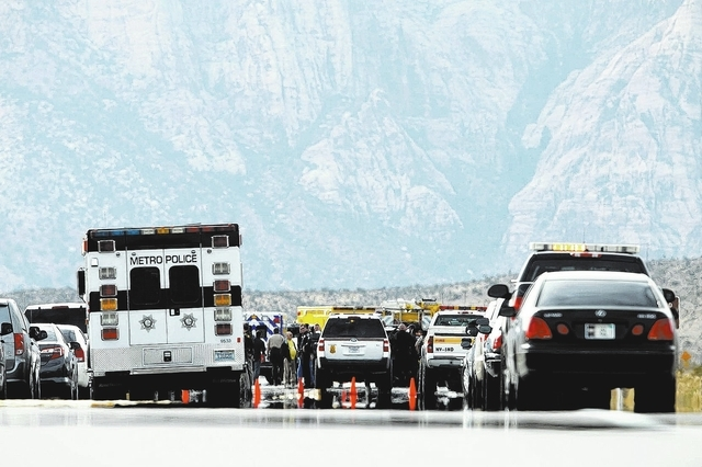 Various agencies are on the scene of a fatal officer involved shooting on State Route 159 in the Red Rock National Conservation Area outside of Las Vegas Friday, Feb. 14, 2014. (John Locher/Las Ve ...