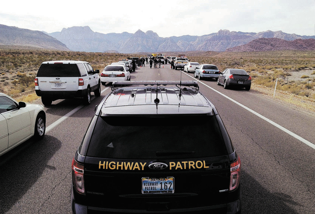 Various law enforcement agencies are on the scene of a fatal officer-involved shooting Friday on State Route 159 in the Red Rock National Conservation Area just west of Las Vegas. (John Locher/Las ...