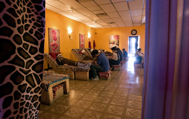 Reflexologists gives costumers massages at Happy Feet, 4970 Arville Street, on Wednesday, Jan. 22, 2014. Clark County commissioners voted Tuesday to regulate reflexologists more closely, with rest ...
