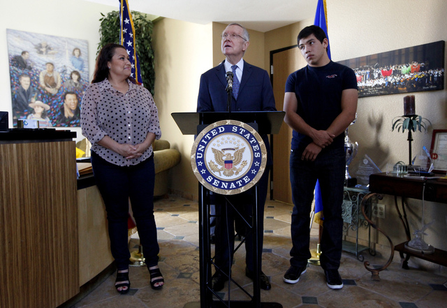 Edith Fawkes, left, stands next to Senate Majority Leader Harry Reid, D-Nev., center, and Brahyam Zurcher, 17, right, at a press conference at the Latin Chamber of Commerce office in Las Vegas on  ...