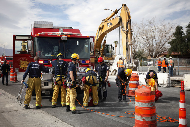 Las Vegas firefighters rescued a worker who was trapped in a trench Wednesday on Vegas Drive near Michael Way. (John Locher/Las Vegas Review-Journal)