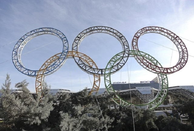 Olympic rings for the 2014 Winter Olympics are installed in the Black Sea resort of Sochi, southern Russia, late Tuesday, Sept. 25, 2012.  The Sohi Olympics have been mired in controversy leading  ...