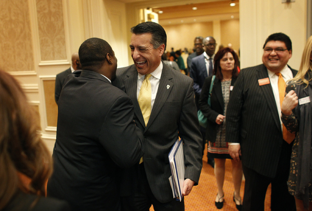 Nevada Governor Brian Sandoval meets with people before speaking at a joint chambers of commerce luncheon at the Venetian in Las Vegas Thursday, Feb. 13, 2014. Gov. Brian Sandoval announced Thursd ...