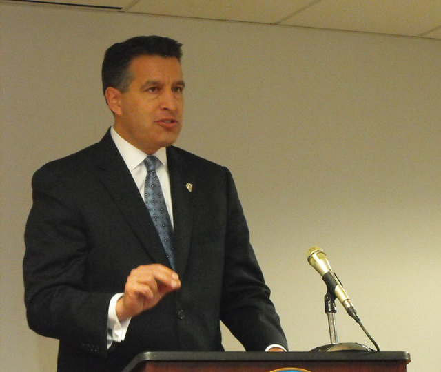 "Nevada Gov. Brian Sandoval describes Nevada's online poker agreement with Delaware at a signing ceremony Tuesday in Wilmington, Del. ""We are standing at a moment in history today,"" Sandoval said.  ..."
