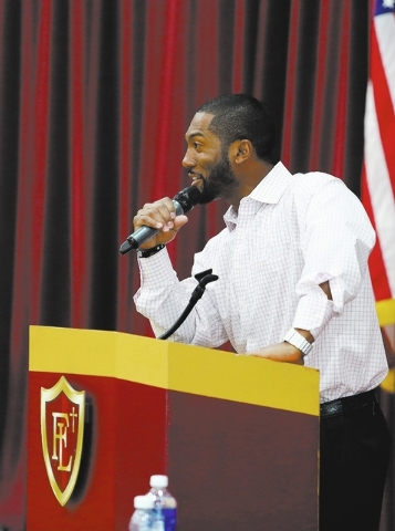 Faith Lutheran Head Football Coach and former NFL player Vernon Vox speaks to Business Advisory Council members during a breakfast seminar at Faith Lutheran Middle School & High School Tuesday, Fe ...