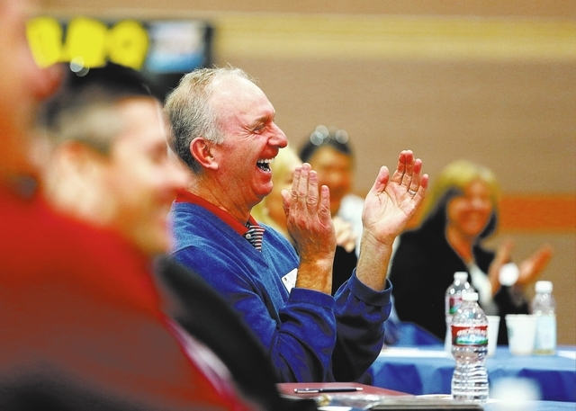 Business Advisory Council member Stuart Engs, center, applauds Boston Red Sox outfielder Shane Victorino during a breakfast seminar at Faith Lutheran Middle School & High School Tuesday, Feb. 4, 2 ...
