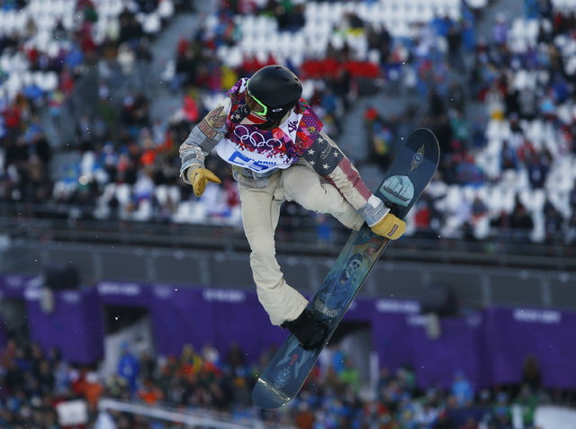 Shaun White of the United States competes during the men's snowboard halfpipe qualifying session Tuesday at the 2014 Winter Olympics in Krasnaya Polyana, Russia. He placed fourth. (AP Photo/Sergei ...