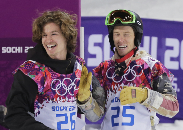 Switzerland's Iouri Podladtchikov, left, celebrates with Shaun White of the United States after Podladtchikov won the gold medal in the men's snowboard halfpipe final at the 2014 Winter Olympics o ...