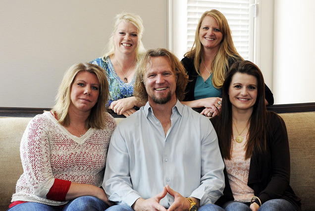 Kody Brown poses with his wives in 2013 at one of their homes in Las Vegas: back row, Janelle, left, and Christine; bottom row, Meri, left, Kody and Robyn. They are the polygamist family featured  ...