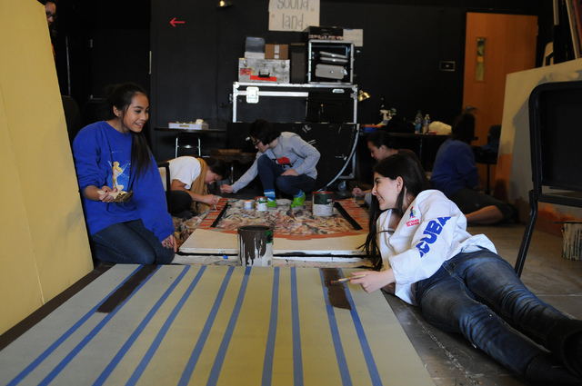 """Freshmen Amber Berky, right, and Francesca Tabora, backstage crew members, paint a set piece for the upcoming play """"Bye Bye Birdie"""" at the Bishop Gorman High School, Feb. 4. (Erik Verduzco/View)"""