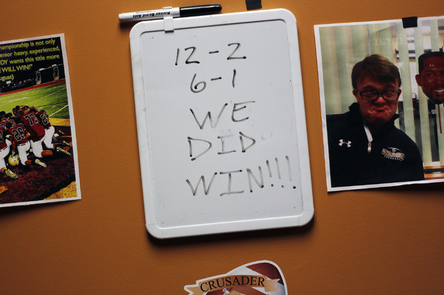 "A message is seen on the door leading to head football coach Vernon Fox's office at Faith Lutheran. According to Fox, the team's motto this past season was ""We will win."" (Jason Bean/View)"