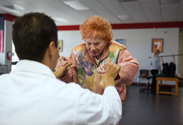 Sylvia Duboys, 95, does exercises with Dr. Anthony Tabor during a physical therapy session at the Keith Kleven Institute, 3820 S. Jones Blvd., Jan. 30. Duboys says staying active is an important c ...