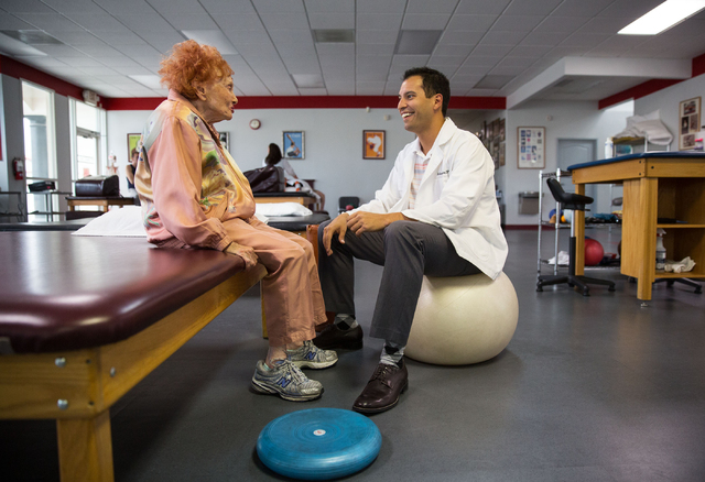 Sylvia Duboys, 95, and Anthony Tabor, a doctor of physical therapy, talk during Duboys' session at the Keith Kleven Institute, Jan. 30. (Samantha Clemens/View)