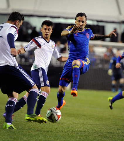Colorado's  Vicente Snchez, right, attacks the ball with Chivas USA's Bobby Burling, center, and Carlos Alvarez defending during a preseason MLS match at Sam Boyd Stadium on Sunday, Feb. 16, 2014. ...