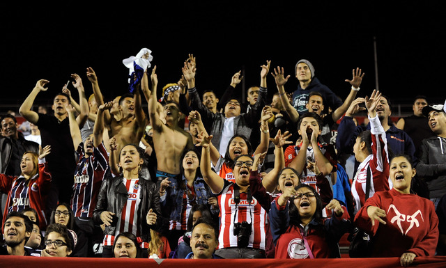 Chivas USA fans cheer during a preseason MLS match against the Colorado Rapids at Sam Boyd Stadium on Sunday, Feb. 16, 2014. (David Becker/Las Vegas Review-Journal)