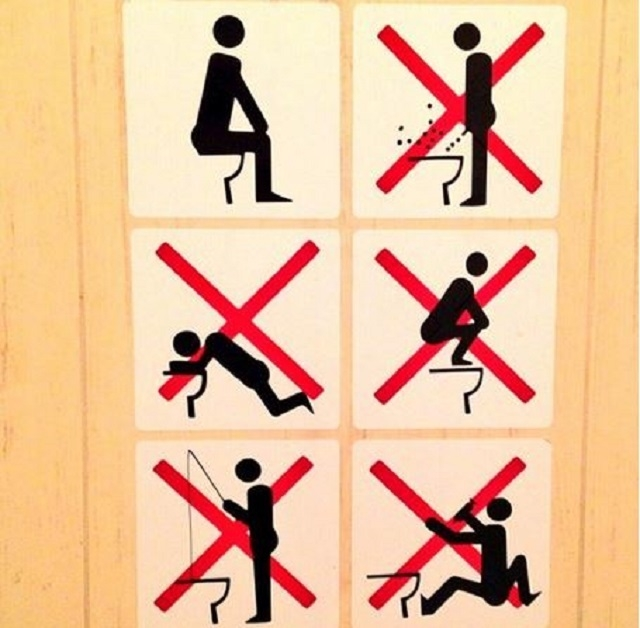 A sign posted in the restroom of a Sochi Olympic venue went viral over the weekend after Canadian snowboarder Sebastien Toutant tweeted it. (@SebToots/Twitter)