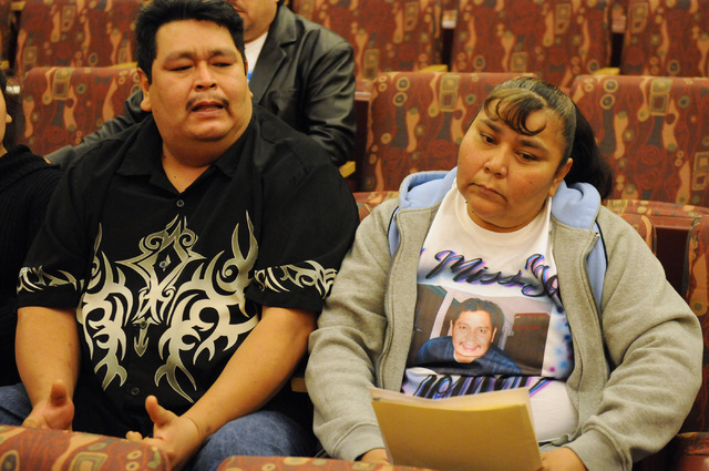 Julio Solano, left, and Adriana Solano, talk to each other during a public hearing on the death of their brother Luis Solano, who died while being restrained by Clark County jail guards last year, ...