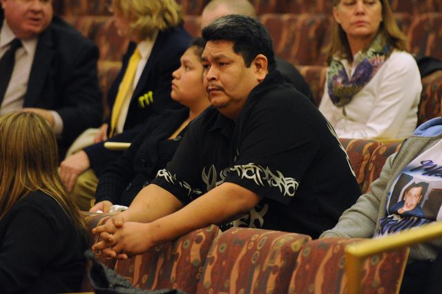 Julio Solano, center, sits with family during a public hearing on the death of his brother Luis Solano, an inmate who died while being restrained by Clark County jail guards last year, at the Comm ...