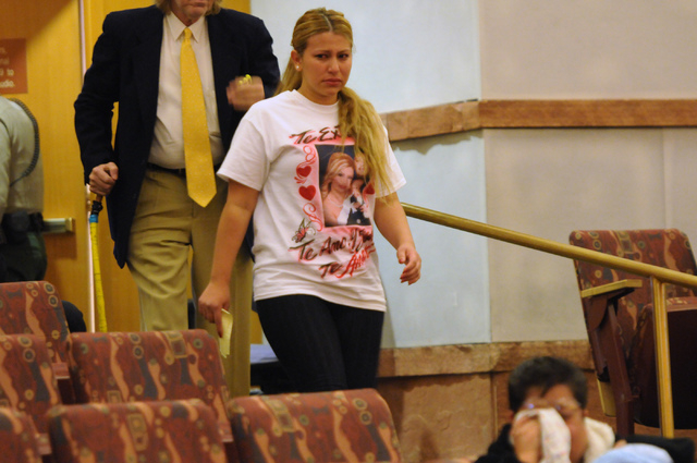 Ima Flores Zelaya comes back to her seat at the public hearing on the death of her husband Luis Solano, an inmate who died while being restrained by Clark County jail guards last year, after stepp ...