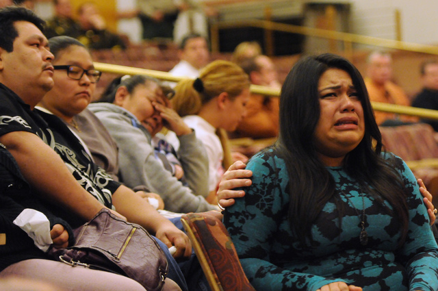 Carmen Solano, 18, right, breaks down in tears watching a video of her father Luis Solano being restrained by Clark County jail guards last year during a public hearing on his death at the Commiss ...