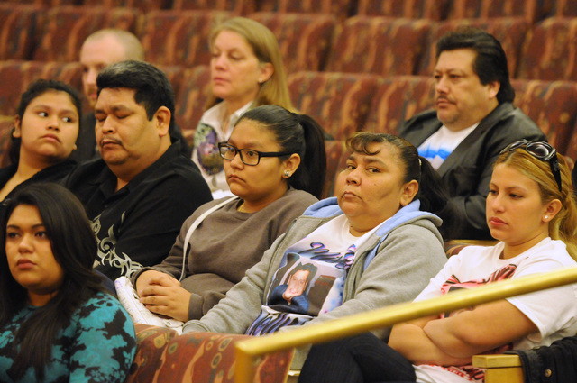 The family of Luis Solano, an inmate who died while being restrained by Clark County jail guards last year, listen in during a public hearing on the death of Solano at the Commission Chambers insi ...