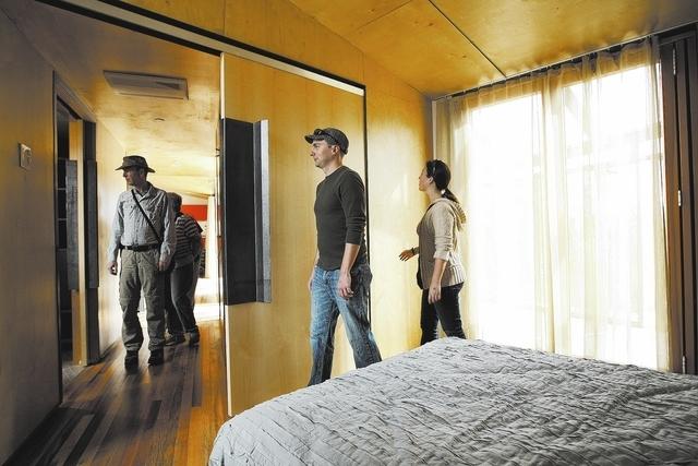 Veronica Jensen, right, and Steve Feiler tour the DesertSol house exhibit at the Springs Preserve in Las Vegas Saturday, Feb. 15, 2014. (John Locher/Las Vegas Review-Journal)
