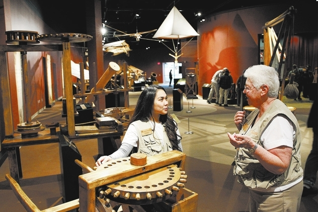 Volunteer docent Dolores Barrett, right, shows fellow volunteer docent Charmay Alonzo a machine designed by Leonardo da Vinci at the Leonardo da Vinci: Machines in Motion exhibit at the Springs Pr ...