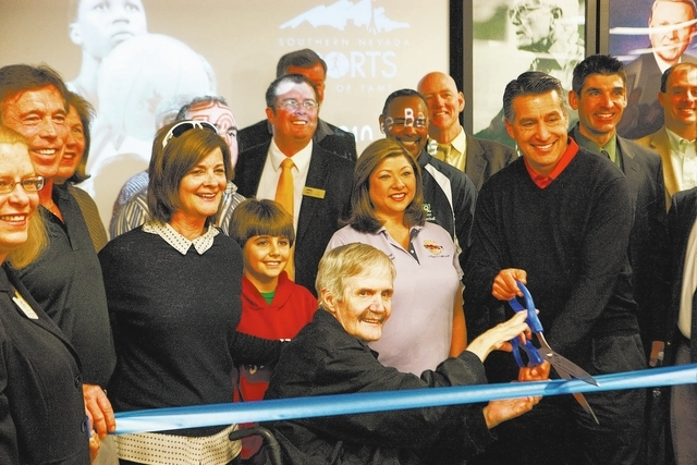 Gov. Brian Sandoval, right, with former NFL quarterback David Humm, cut the ribbon at the rededication ceremony of the new Southern Nevada Sports Hall of Fame location at Findlay Toyota, 7733 East ...
