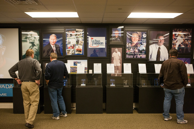 People look through memorabilia before the start of the rededication ceremony of the new Southern Nevada Sports Hall of Fame location at Findlay Toyota, 7733 Eastgate Road in Henderson, on Saturda ...